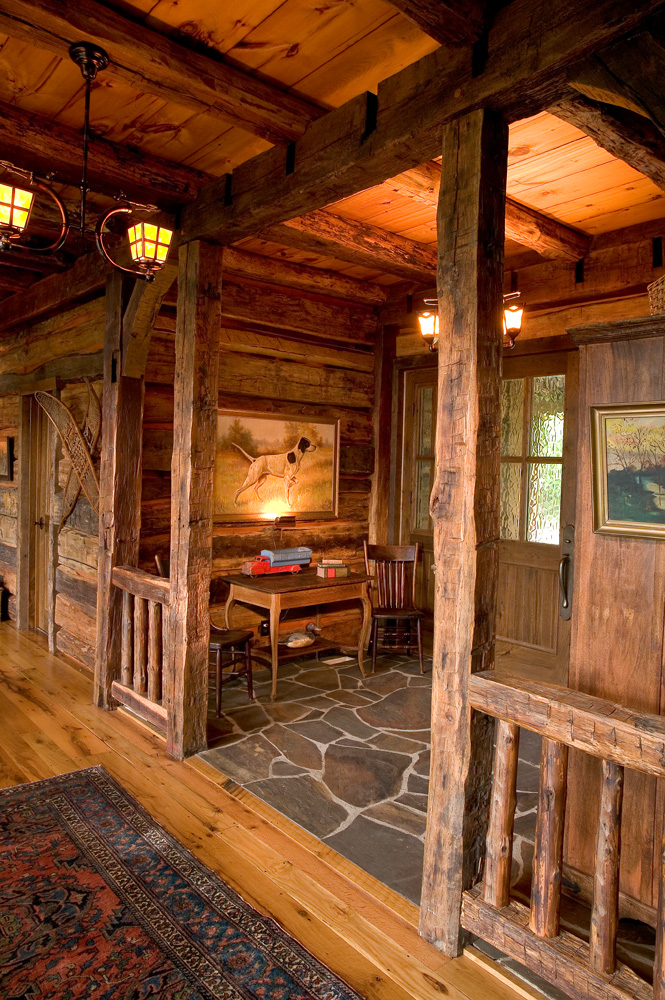 Log Home Foyer : Big wood timber frames the lodge